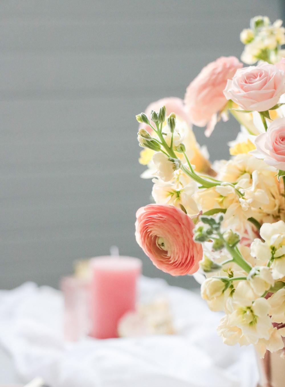 spring centerpiece detail of peach ranunculus by Studio Bloom Iowa floral designer