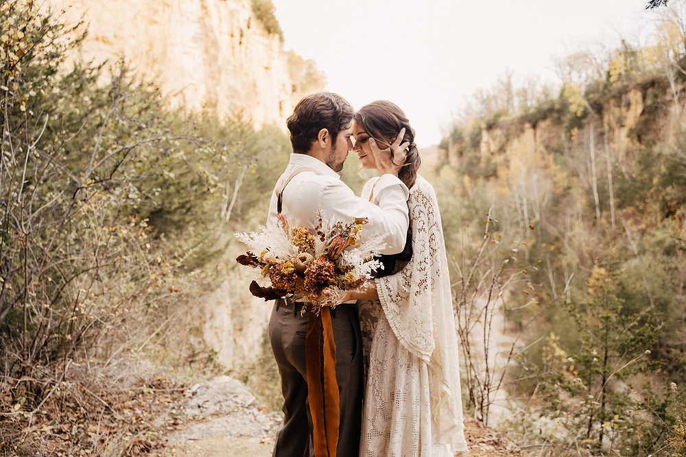 boho bride and groom with dried floral bridal bouquet by Studio Bloom Iowa