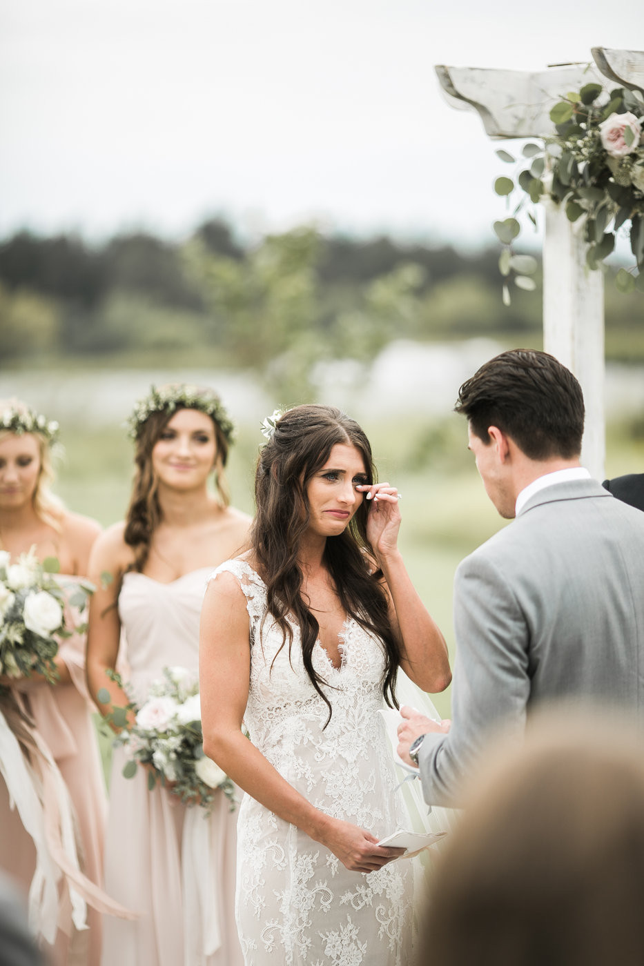 emotional bride crying tears of joy during vows at an outdoor wedding ceremony