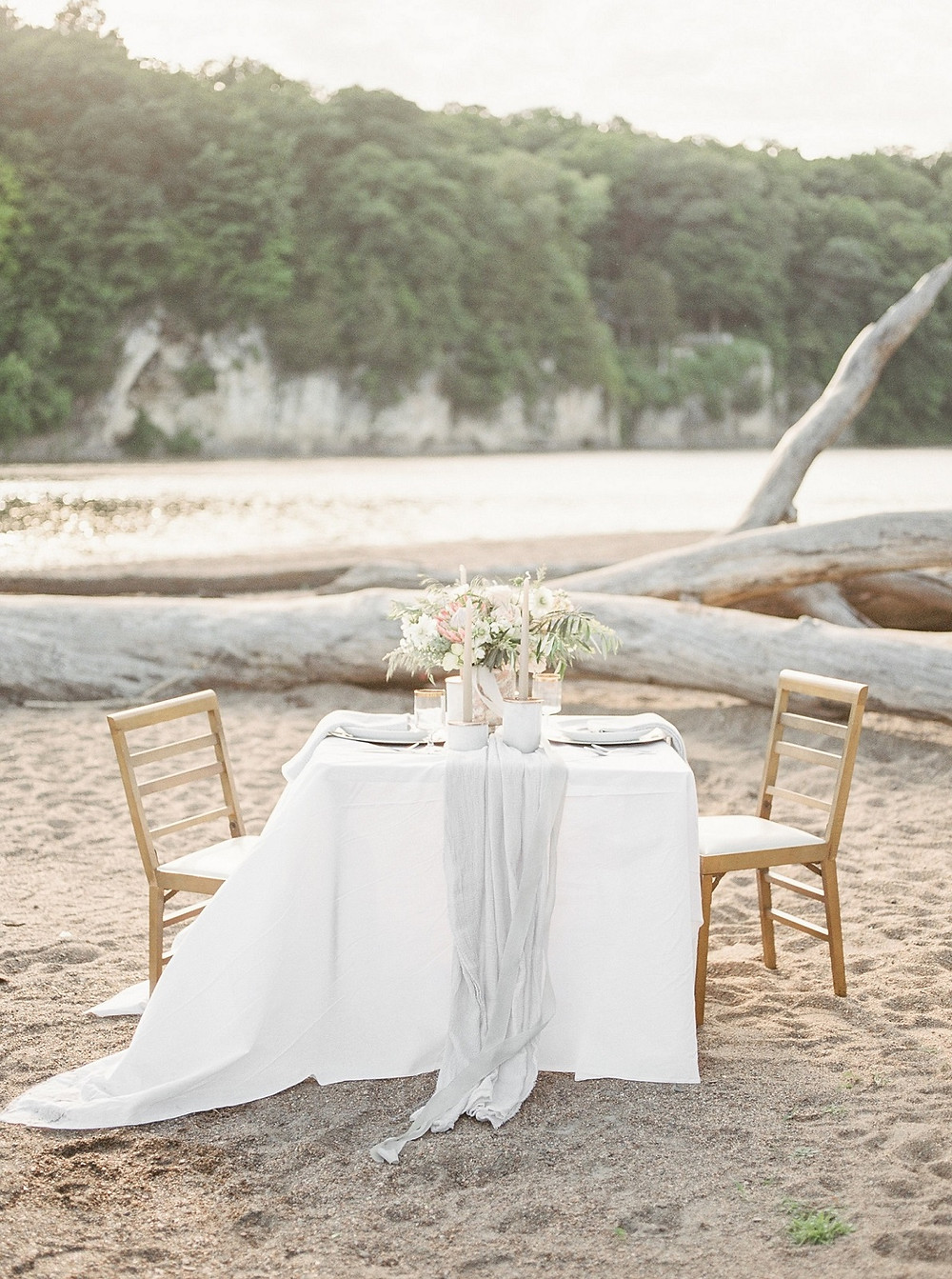 wedding sweetheart table inspiration at Palisades Kepler Park beach with flower centerpiece, candles, and table runner