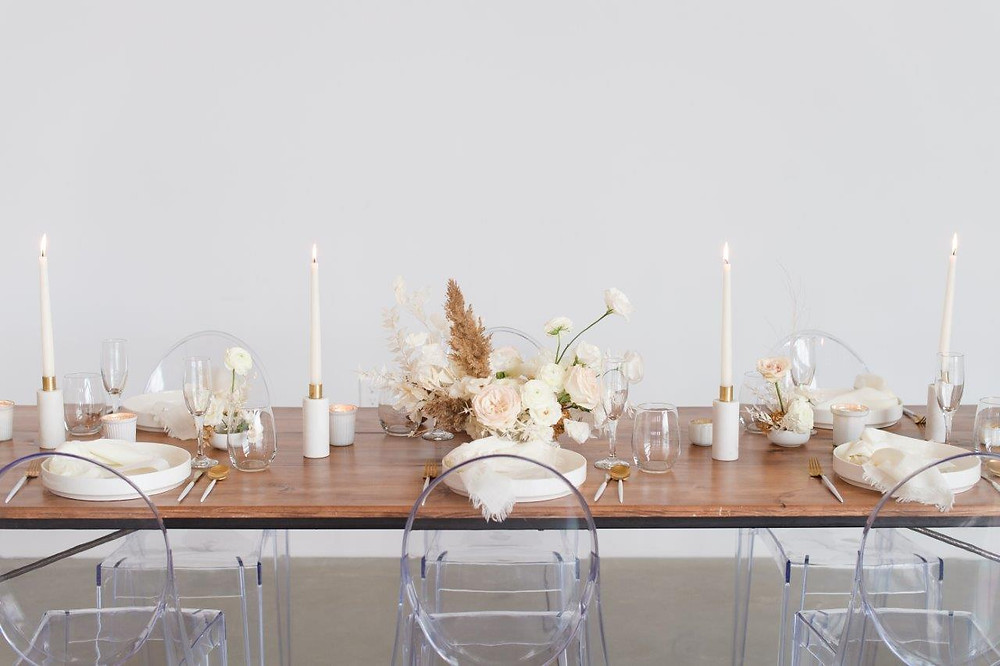 Minimalist wedding centerpiece by Studio Bloom Iowa of white garden roses, carnations, lisianthus and pampas at Little Lights