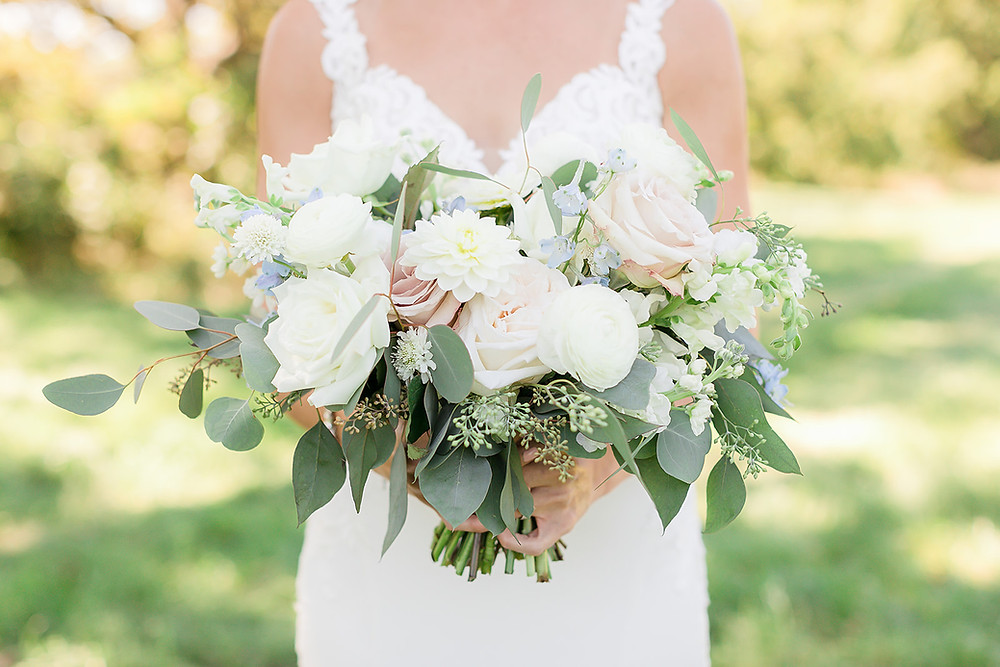 Studio Bloom Iowa bridal bouquet of roses, dahlias, ranunculus, delphinium, and eucalyptus