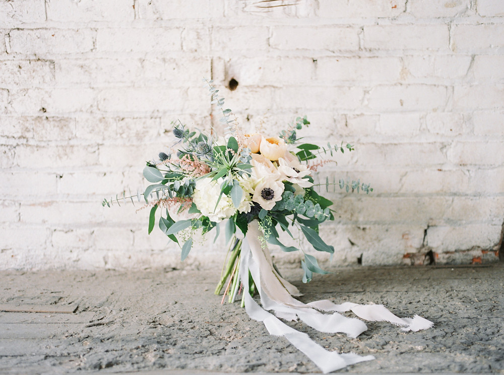 Bridal bouquet by Studio Bloom Iowa of anemone, juliet garden roses, and eucalyptus