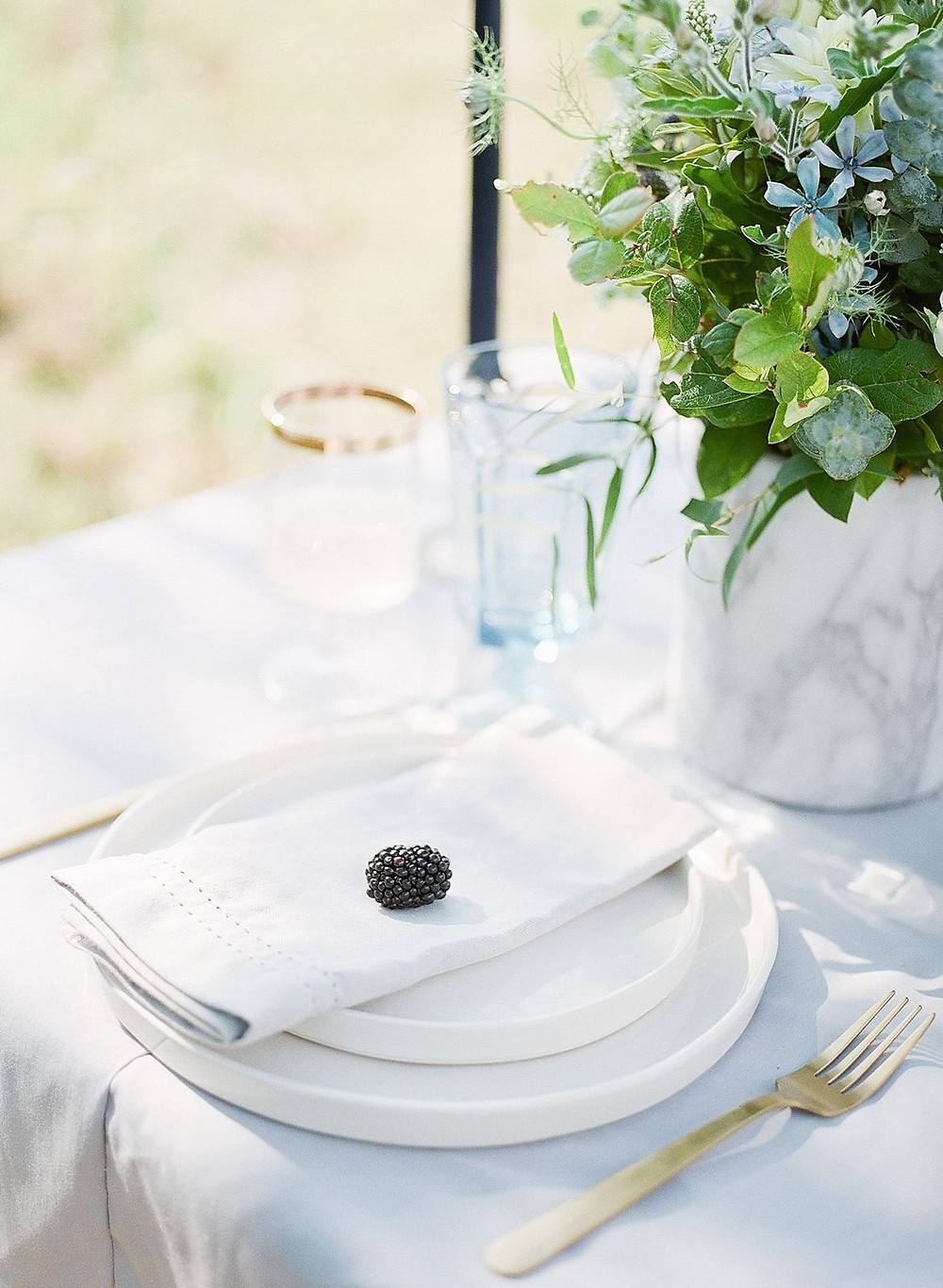 detail of blackberry on place setting