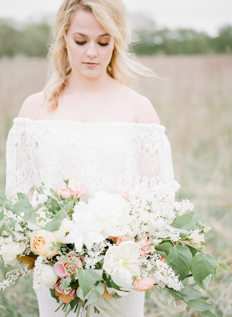 lush country bridal bouquet of peonies, lilac, roses, and spirea by Studio Bloom Iowa