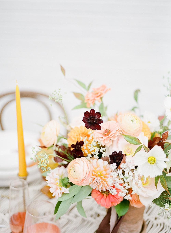 Boho wedding centerpiece by studio bloom iowa cedar rapids wedding florist with zinnias ranunculus cosmos and queen annes lace