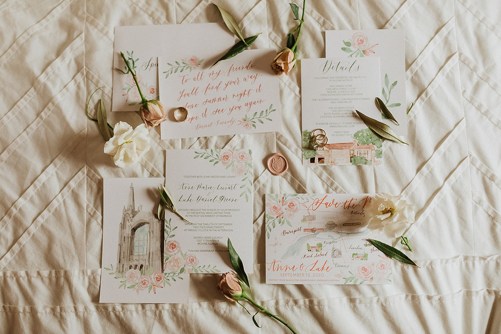 watercolor wedding invitation flatlay with flowers