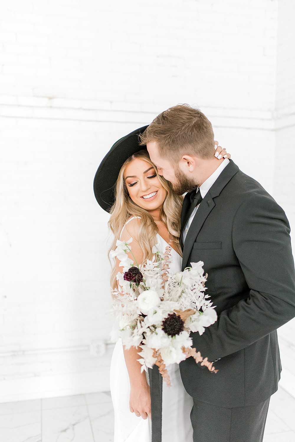 hipster bride and groom with modern black and white bridal bouquet by Studio Bloom Iowa wedding florist