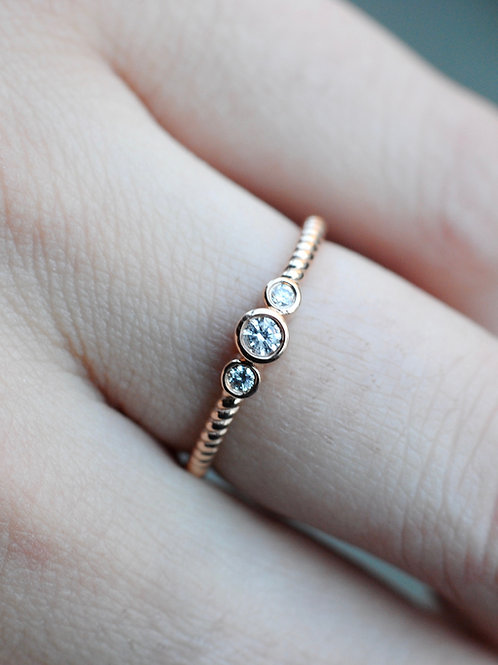 Three Stone Diamond Ring with Twisted Band in 14k Rose Gold