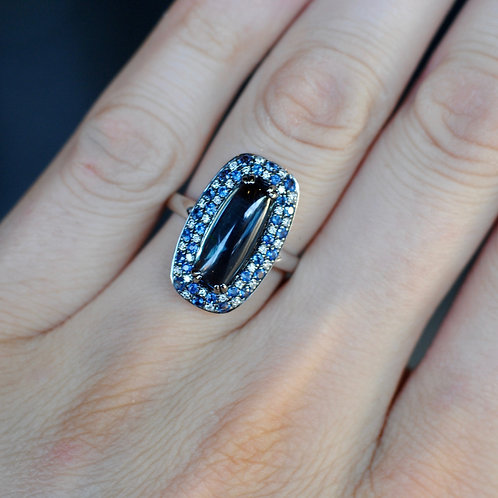 Blue Topaz Ring with Diamond and Sapphire Accents
