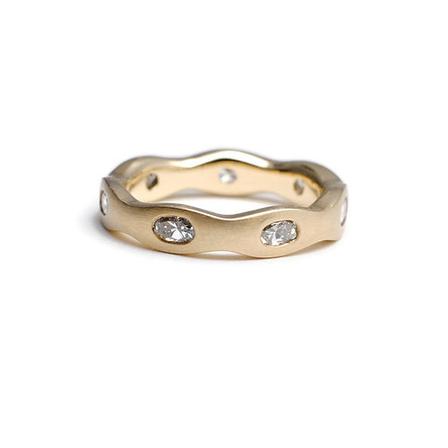 Yellow Gold Band with Gypsy Set Oval Diamonds