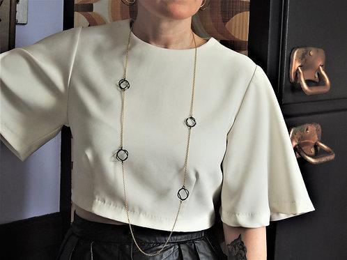 Wavy Black Circles Drape Necklace by Mysterium