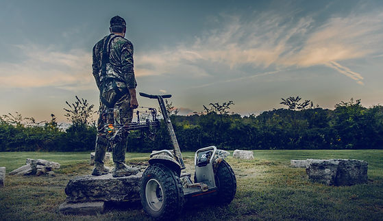Segway x2 and bow hunter in nature