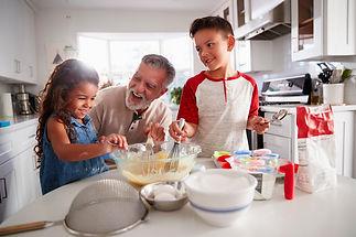 Man Older Grandkids Kitchen.jpg