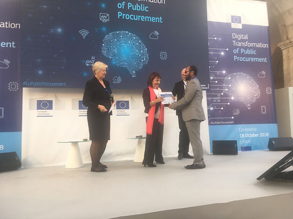 PublicBI receiving award at the Digital Transformation of Public Procurement Conference, Lisbon