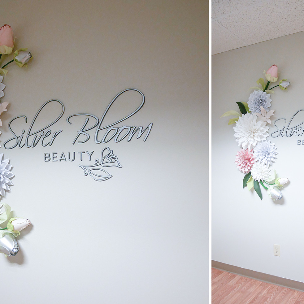 Large paper flower and acrylic signage installation