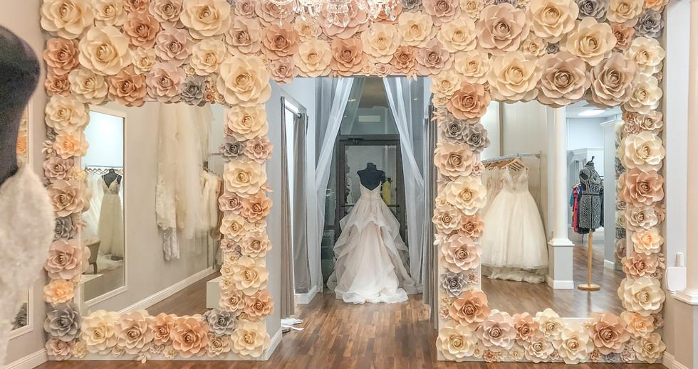 Full paper flower backdrop at Elizabella's bridal