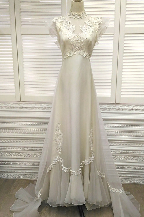 Off White vintage wedding gown with ruffle sleeves and train