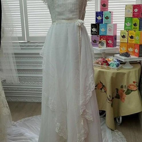White vintage wedding gown with long train