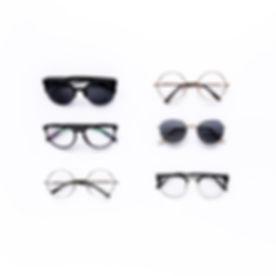 Female sunglasses on white background.jpgFlat lay, top view.jpg