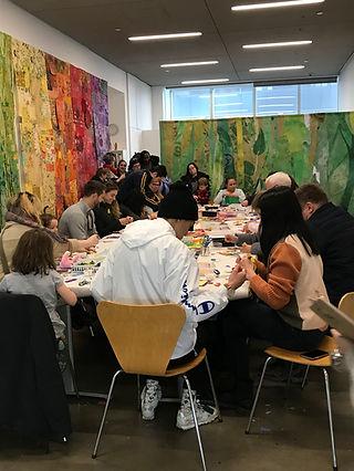 table full of people working.jpg