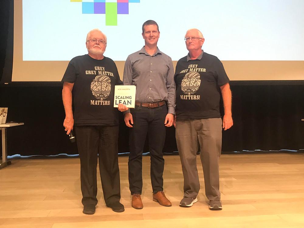 Matthew MacKenzie accepts win at Aging 2.0 Halifax Global Innovation Challenge alongside event organizers John Hamblin, left, and Ed Leach, right.