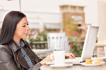 Woman-at-outdoor-cafe-using-laptop.-6537