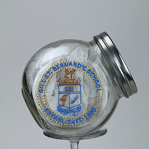 School emblem onto jar