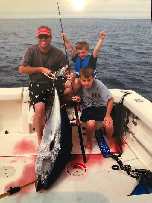 Jay and Kids with Tuna caught on Reliabl