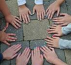 girls circle hands.jpeg