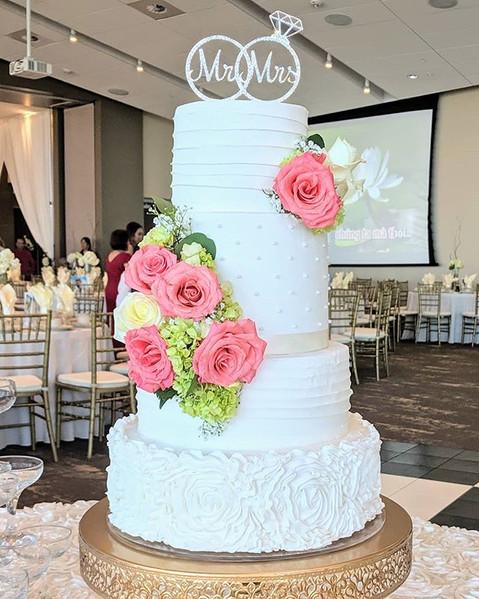 Gorgeous buttercream wedding cake with f