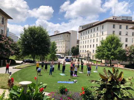 Dr. Caston leads Yoga on Emory SOM lawn