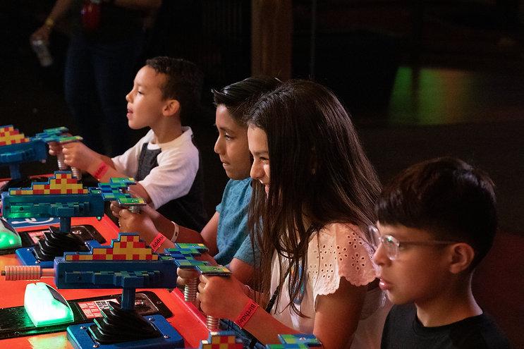 kids playing arcade game.JPG