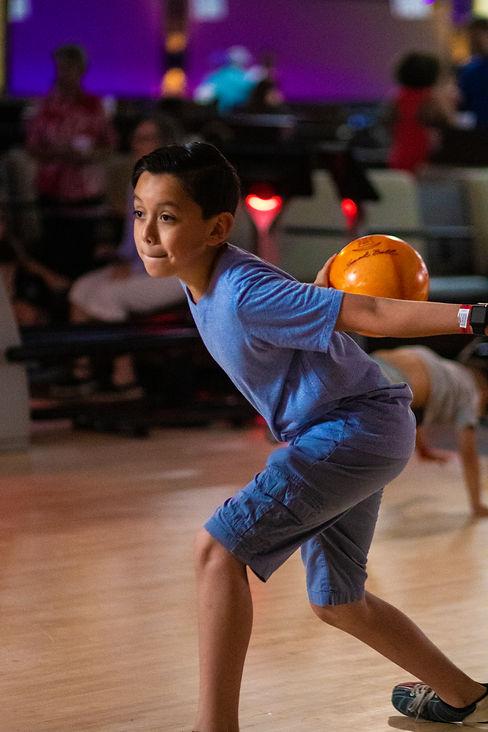 kid bowling at grand station.JPG