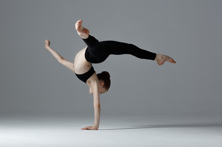 Young gymnast girl stretching and traini