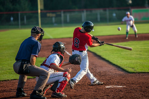 Baseball batter hits the ball.jpg