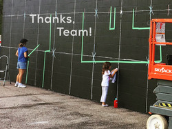mural team with kids