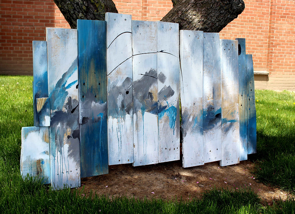 abstract painting on reclaimed wood with blue and white outdoors