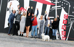Snugglers Team Celebrating their new mural