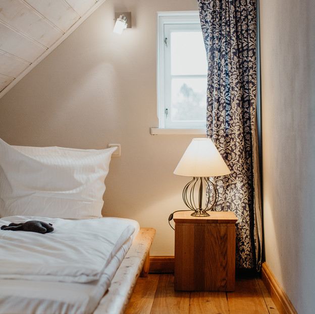Schlafzimmer_4_Darßer_Kapitänshaus_Wieck