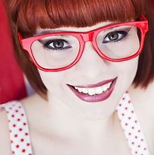 Girl wearing red glasses