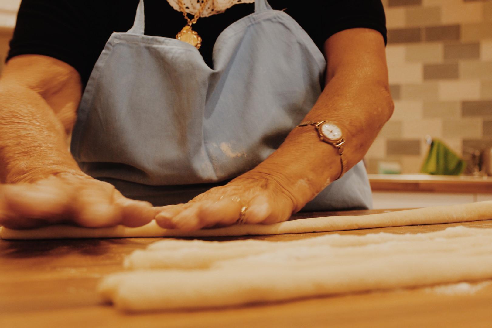 Nonna rolling pasta