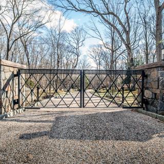 Custom-wrought-iron-modern-driveway-gate