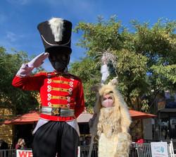 masked holiday stilt walkers