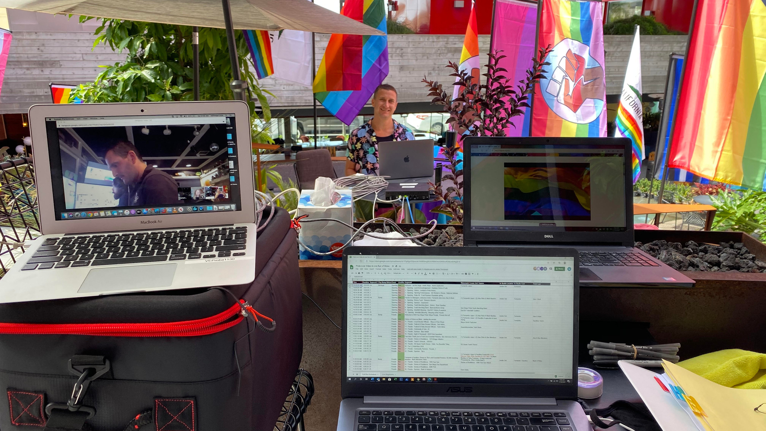 Three computers set up and ready for Pride Live to begin streaming