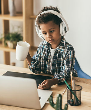 little%20boy%20with%20headphones%20and%20cup%20looking%20at%20laptop_edited.jpg