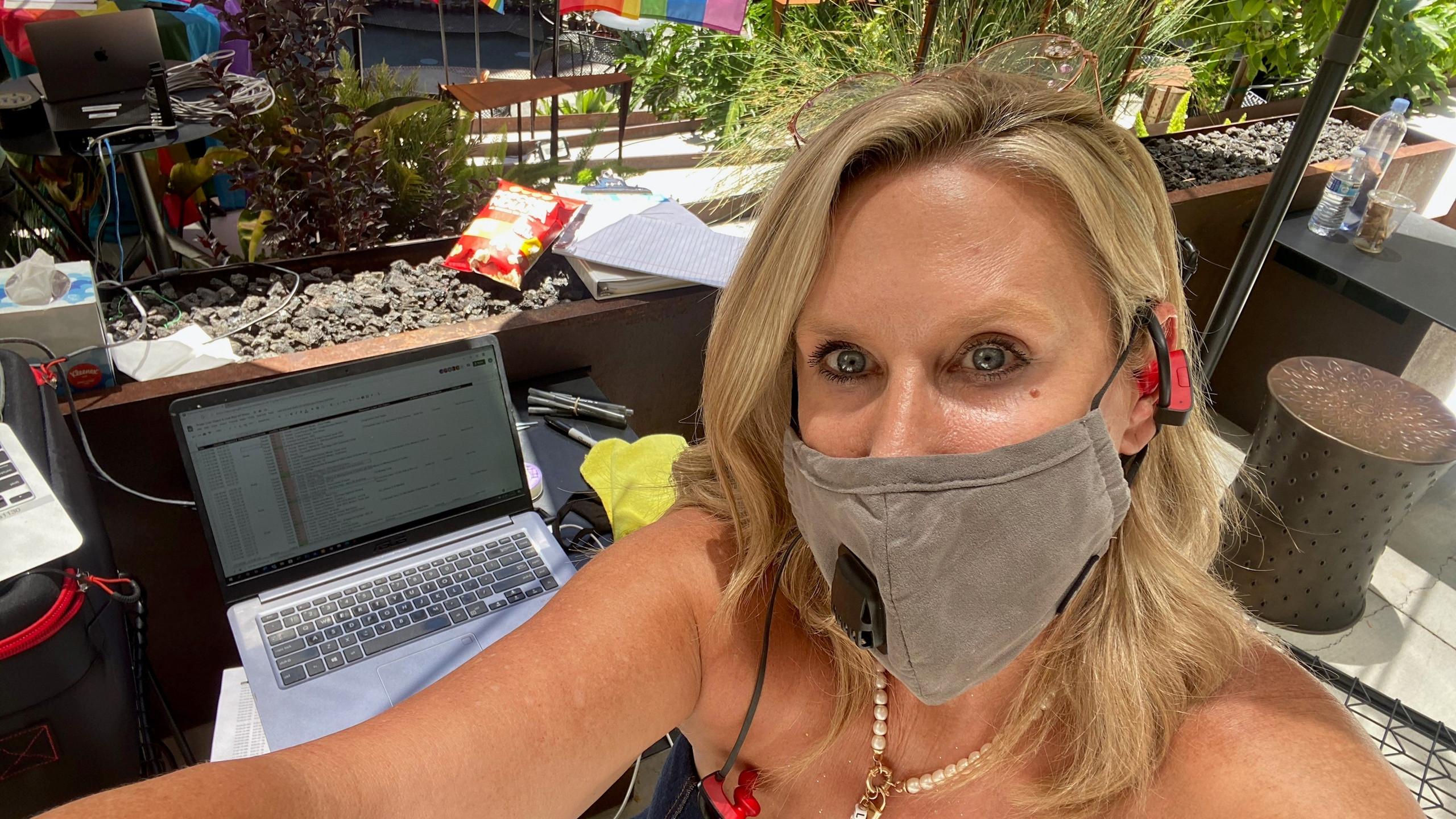 Laurel McFarlane in masks directing Pride Live