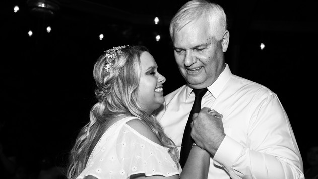 Wedding reception father daughter dance in black and white. Dad jokes seem to work in these moments. This photo was captured by Kidus Solomon, wedding photographer in the Dallas, Austin, Plano, and surrounding areas.