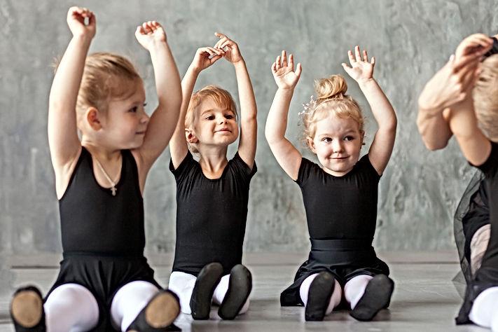 little girls ballerina in black dresses,