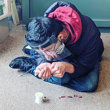Mohamad Making Bracelets at One World Sh